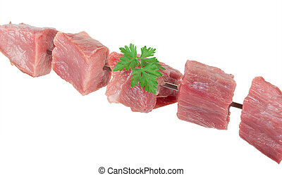 Pieces of raw meat on a skewer