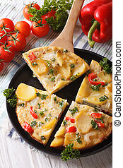 Pieces of Spanish tortilla with potatoes closeup. vertical top view
