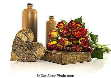 piedra, botella, con, viejo, libro, y, rosas rojas