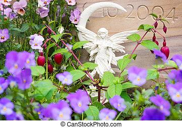 piedras, ángel, entre, frente, flores, tumba