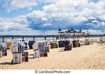 Pier and beach chairs in Ahlbeck on the island Usedom, Germany