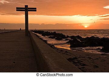 Pier and beach Hoek van Holland at sunset