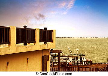 Pier and small passenger ship - Small passenger ship docked...
