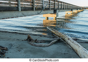 A view of the fishing pier in Dash Point, Washington at high tide.