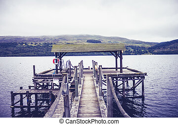 Pier at lake on gloomy day