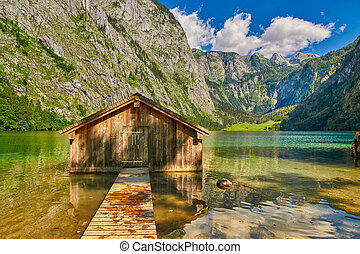 Pier at picturesque Obersee lake in Bavaria, Germany