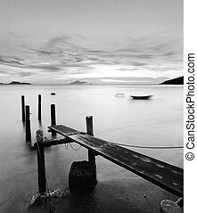 pier at sunset in black and white
