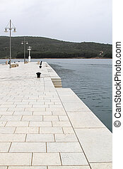 Pier Cres - Rainy day at white marble stone pier in Cres