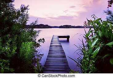 pier in lake at sunrise
