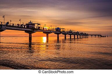 Pier in Miedzyzdroje at sunset