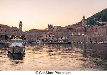 Pier in old town of Dubrovnik at sunset