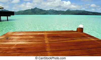 pier in sea at tropical beach in french polynesia - travel,...