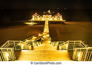 Pier in Sellin, the Jewel of Rugia Ruegen Baltic Coast island at Night, color toning applied, Germany