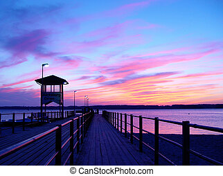pier in sunset - pier in a sea resort in north germany ...