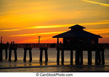 Pier in the ocean - Silhouette of a pier in the Atlantic...