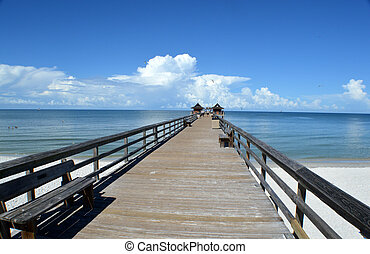 Pier leading to clouds - This is a photo of a pier appearing...