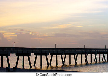 PIer on a beach at sunrise