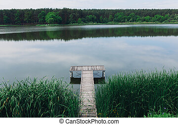Pier on a calm river in the summer