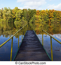 pier on a lake in autumn