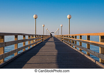 Pier on shore of the Baltic Sea in Heiligendamm, Germany.