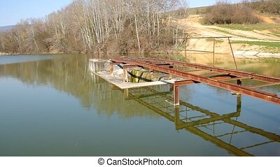 Pier on the bank of a pond