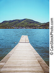 Pier on the beautiful summer Como lake in Italy.