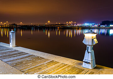 Pier on the Potomac River at night, in National Harbor, Maryland.