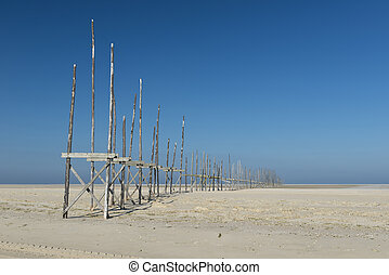 Pier on the sandbar the Vliehors on the island of Vlieland