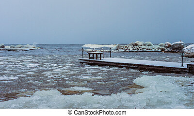 pier on the shore of winter lake