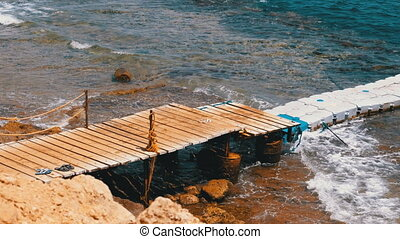 Pier or Pontoon on a Beach in Egypt over a Reef off the...