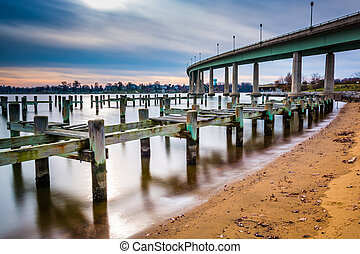Pier posts in the Severn River and the Naval Academy Bridge,...