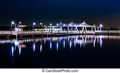 Pier reflecting in the Potomac River at night, in National Harbor, Maryland.