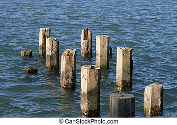 Pier remains - pillars of remaining pier in the water