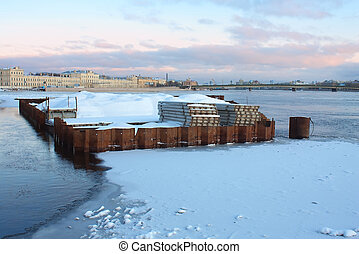 Pier repairing works in winter, St. Petersburg, Russia