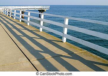Pier Shadows 1 - Handrail shadows on a pier in Germany