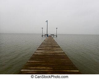Pier to Ocean in Gulf of Mexico on Misty Dark Day