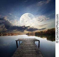 Pier under moon - Fishing pier on a river under fool moon....