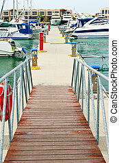Pier with moored yachts