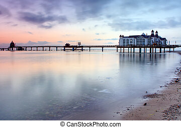 Beautiful pier with restaurant in Sellin, Baltic Sea, Germany, in the early morning hours