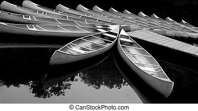 Pier with tied up canoes