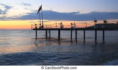 Pier with Turkish  flag at sunrise in Kemer, Turkey