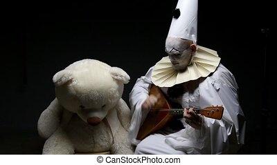 Piero playing the balalaika, video on black background