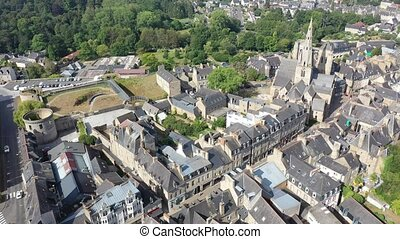Flight over the city Guingamp and Basilica of Our Lady of Merciful on summer day. France