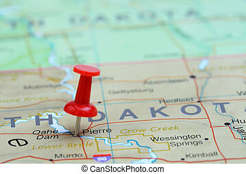 Photo of pinned Pierre on a map of USA. May be used as illustration for traveling theme.