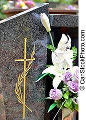 pierre tombale, à, croix, et, fleurs