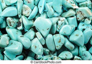Pierre turquoise gem stone background, closeup