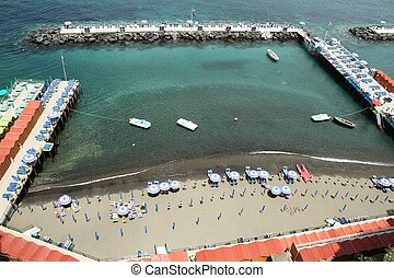 Piers of Sorrento - Piers extending out in the ocean with...