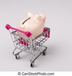 pig money box in shopping cart on white background