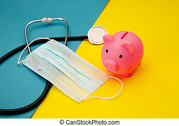 Pig moneybox, face mask and stethoscope on colorful background. Spending money on pills and expensiveness of medicine concept