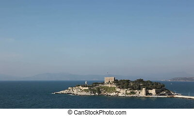 Pigeon Island Fortress, also known as the Pirates castle, in the Kusadasi harbor, on the Aegean coast of Turkey.